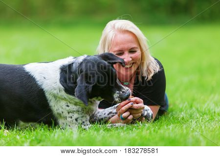Portrait Of A Woman With Her Dog On The Meadow