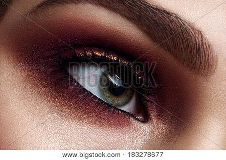 Macro beauty Woman's vinous Smoky Eye commercial Make-up