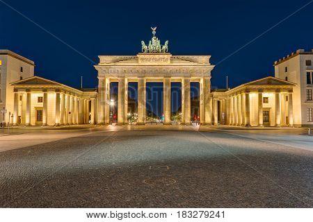 The famous Brandenburg Gate in Berlin illuminated at darkness