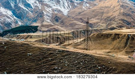 mountain landscape in Georgia and poles with wires