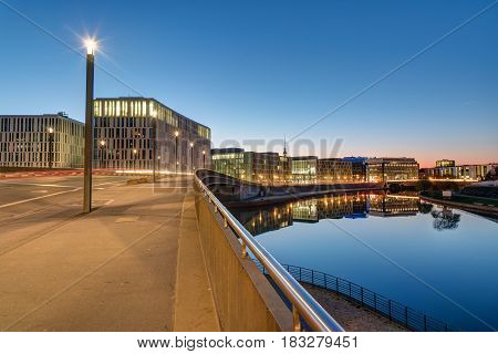 Bridge and office buildings at the river Spree in Berlin in the early morning