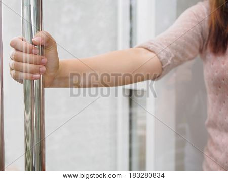 Woman's hand open the door with glass reflection background