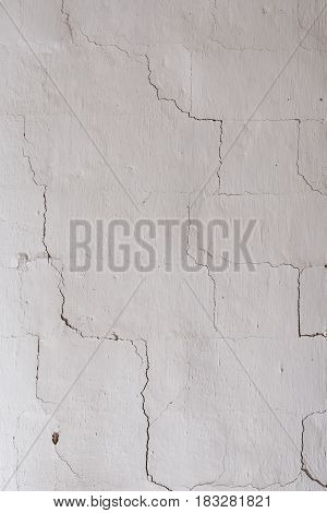 cracks on a white wall. texture, roughness
