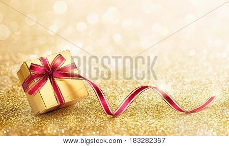 Gift box with ribbon against bokeh lights background