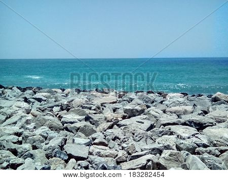 Amazing sea with blue summer wave and rocks. Summer sea background. Endless sea. Daylight sea. Turquoise sea. Sea foam, Sunny day sea view with Sea rock & perfect background
