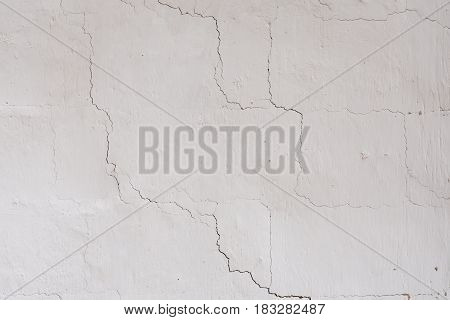 The texture on the white wall. cracks, roughness