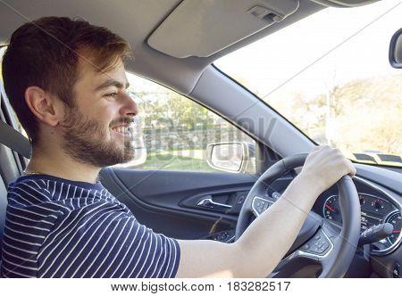 Handsome Man Hand On Steering Wheel