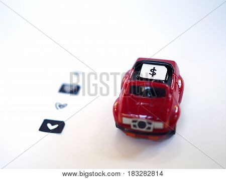 Sim card tray and small paper simulated as a SIM card on a red toy car with white background. Dollar wifi and heart symbol on paper sim cards.