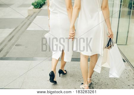Beautiful Asian Girls With Shopping Bags Walking On Street At The Mall