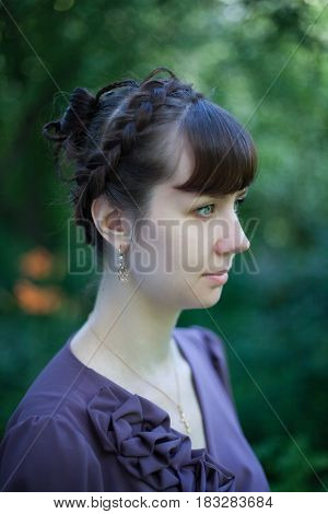 Portrait of a young woman with a fashion hairstyle