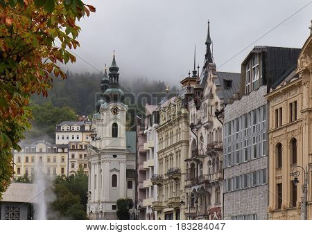 Autumn street in Karlovy Vary (Karlsbad) Czech Republic with Church of St. Mary Magdalene