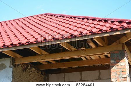 Repair old house with renovation and new metal roof installation and repair wooden trusses. Unfinished house roof repair.