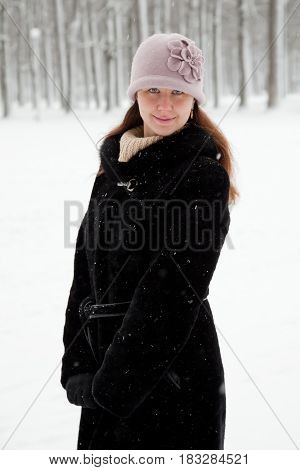 Cute young girl posing on winter background