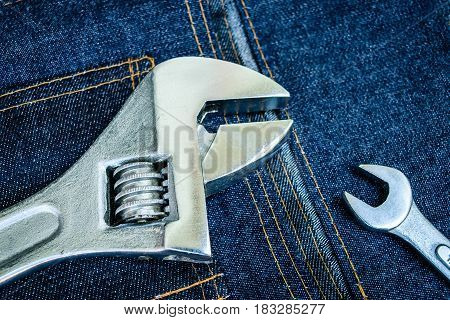 variety of tools in belt bag jeans