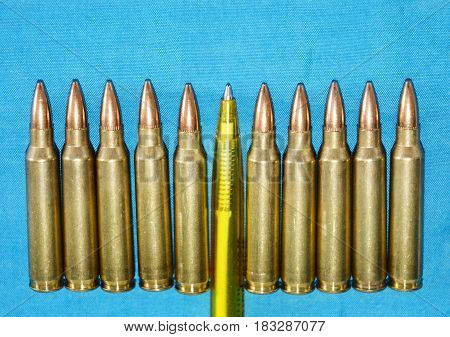 Cartridge 5 56 Mm Caliber With Pen as a Concept of Propaganda in Mass Media. Fake News Invasion Concept.