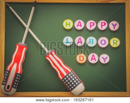 Labor day background concept - many handy tools with labor day text on blackboard background top view