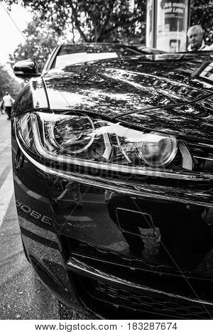 BERLIN - JUNE 14 2015: Fragment of the compact executive car Jaguar XE 20D (since 2015). Black and white. The Classic Days on Kurfuerstendamm.