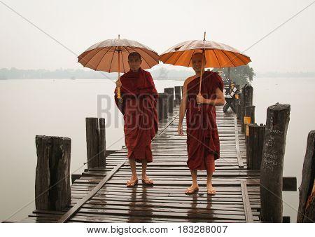 Buddhist Monks Walking On Ubein Bridge
