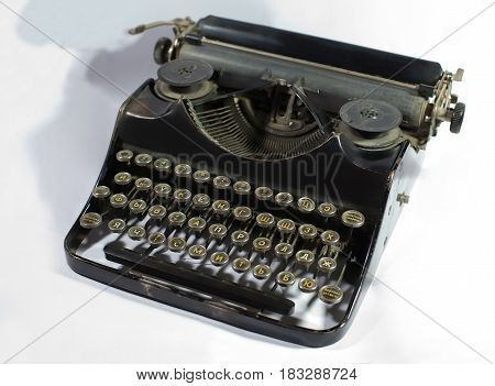 Antique typewriter on white background. Mechanism for printing text