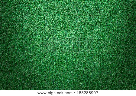 Green grass texture, green grass background. Top view of artificial green grass for golf course and soccer field.