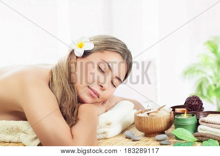 Woman relaxing at spa, peaceful female sleeping on massage table, closing eyes, health care and harmony of body, enjoying day in the beauty salon