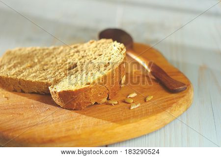 Bread slice organic natural food homemade wholegrain healthy nutrition. Selective focus crust piece. Rustical bread oldstyle eating. Tasty baker meal closeup.