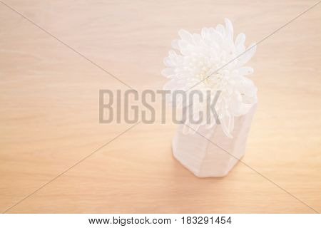 Contemporary Wooden Table With White Flower stock photo