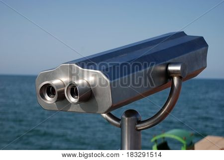 Sea binoculars.Marine binoculars for tourists at the seaside.