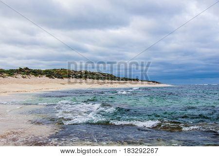 Thick cloudy skies over choppy waves at Prevelley Beach, Margaret River.