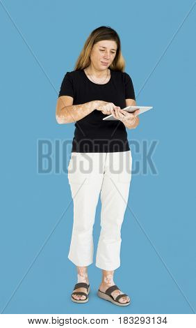 Caucasian woman full body standing and using digital tablet
