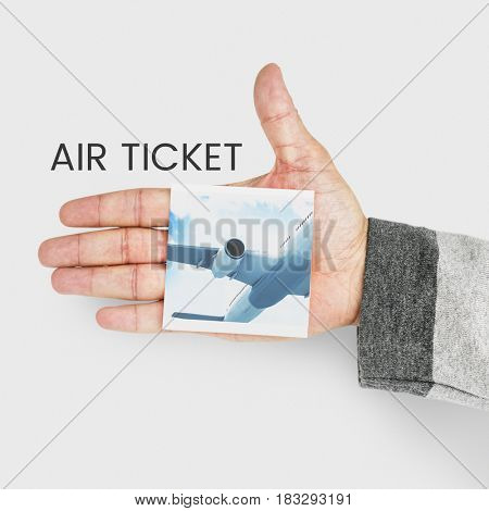 hand holding banner with illustration of air ticket booking for travel destination
