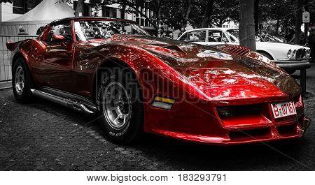 BERLIN - JUNE 14 2015: Sports car Chevrolet Corvette C3 Stingray coupe. Stylization. Toning. The Classic Days on Kurfuerstendamm.