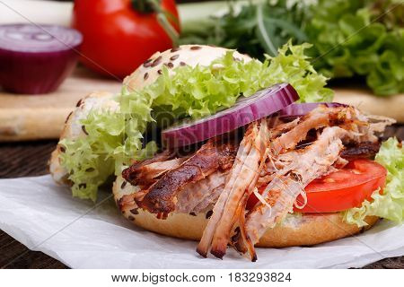 Pulled Pork Burger With Coleslaw Tomato, Onion And Fresh Bread.