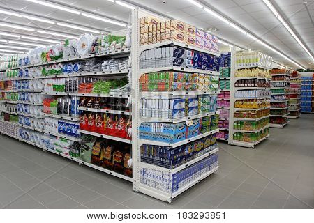 ROME, ITALY. March 26, 2014: Grocery shop shelves with products inside a new market (M.A. Supermarket) opening in Rome, Italy.