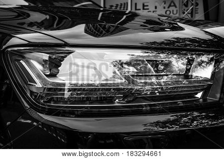 BERLIN - JUNE 14 2015: Headlamp of a full-size luxury crossover SUV Audi Q7 3.0 TDI quattro. Black and white. The Classic Days on Kurfuerstendamm.