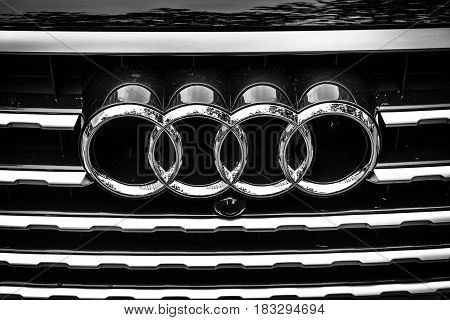 BERLIN - JUNE 14 2015: The emblem on the front grille of a full-size luxury crossover SUV Audi Q7 3.0 TDI quattro. Black and white. The Classic Days on Kurfuerstendamm.
