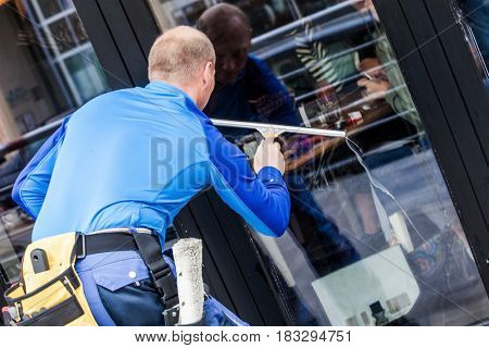 window washer working  wash glass on building