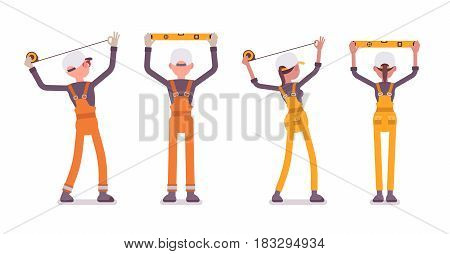 Set of male and female professional worker, wearing bright orange and yellow overall, doing measurement, planning with spirit level and tapeline, full length, rear view, isolated on white background