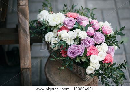 Wedding decor. beautiful flower composition of fresh flowers. concept of a festive dinner, outdoor. rustic style.