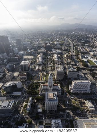 Afternoon aerial view of downtown Los Angeles Civic Center office buildings and the Hollywood Freeway.