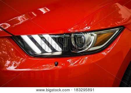 BERLIN - JUNE 14 2015: Headlamp of a pony car Ford Mustang 50th Anniversary Edition 2015. The Classic Days on Kurfuerstendamm.