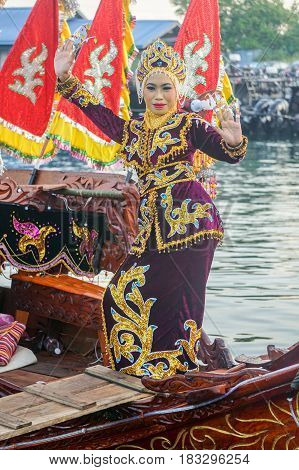 Semporna,Sabah-Apr 22,2017:Sea Bajau girl of Semporna,Sabah,Borneo in traditional costume during Regata Lepa Lepa in Semporna,Sabah,Borneo.Lepa means Boat in the dialect of east coast Sea Bajau people