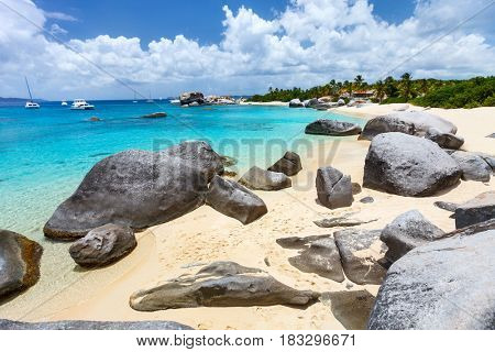 Stunning beach with white sand, unique huge granite boulders, turquoise ocean water and blue sky at Virgin Gorda, British Virgin Islands in Caribbean