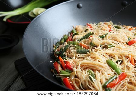 Delicious rice noodle with vegetables in wok