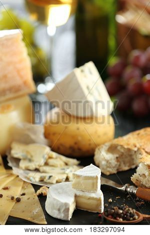Slate plate with variety of cheese on table