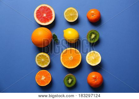 Juicy composition of tropical fruits on blue background