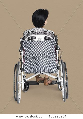 Disable Adult Woman Sitting on Wheelchair Studio Portrait