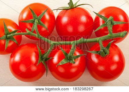 Close up picture of fresh cherry tomato on isolated background