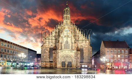 Nuremberg cathedral Frauenkirche in Hauptmarkt wtih rainbow Bavaria Germany