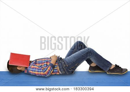 Child Asian is sleeping with red book on his face on isolated.Boy asian with notebook.